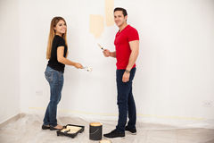 Cute couple painting a wall Stock Images