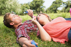 Cute couple in the park blowing bubbles Stock Images