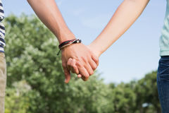 Cute couple in the park holding hands Stock Image