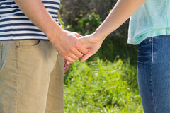 Cute couple in the park holding hands Stock Photos