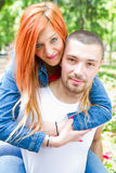 Cute couple in the park on a sunny day Stock Photos