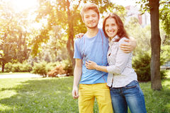 Cute couple in the park on a sunny day royalty free stock photo