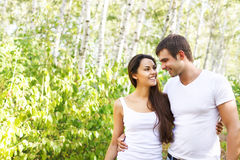 Cute couple in the park on a sunny day. Cute smiling couple in the park on a sunny day Royalty Free Stock Image