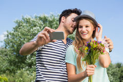 Cute couple in the park taking selfie Stock Images