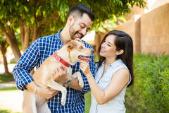 Cute couple petting their dog Stock Photos