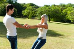 Cute couple playing around in park. Stock Photos