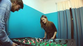 Cute couple plays table football, entertainment, dating stock footage