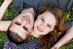 Cute couple portrait - happy lovers. Cute couple portrait - happy young lovers on grass stock photos