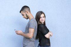 Cute couple posing back to back royalty free stock photo