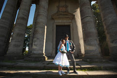 Cute couple posing on background beautiful architecture Stock Photos