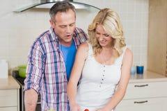 Cute couple preparing food Stock Photo