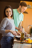 Cute couple preparing food together Royalty Free Stock Photos