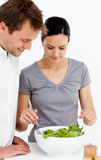 Cute couple preparing a salad together Royalty Free Stock Photography