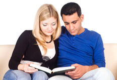 Cute couple reading Royalty Free Stock Images
