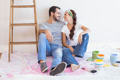 Cute couple redecorating living room Stock Photography