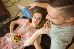Cute couple relaxing on couch at breakfast Royalty Free Stock Photography