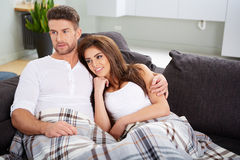 Cute couple relaxing on couch Stock Photography