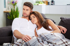 Cute couple relaxing on couch Royalty Free Stock Photography