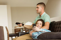 Cute couple relaxing on couch Stock Photo