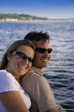 Cute Couple Sailing. Cute couple with big smiles on a sailboat on Elliott Bay in Seattle, WA stock photo