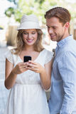 Cute couple sending a text message Royalty Free Stock Photography