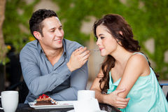 Cute couple sharing cake at a cafe Royalty Free Stock Image