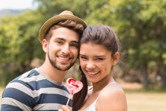 Cute couple sharing a lollipop Royalty Free Stock Image
