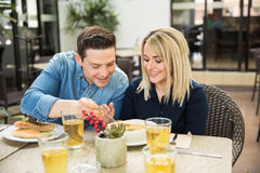 Cute couple sharing some food Royalty Free Stock Images