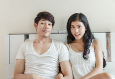 Cute Couple Sitting On Bed Royalty Free Stock Images