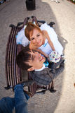 Cute couple sitting on the bench and smiling on background lviv stock images