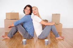 Cute couple sitting on the floor Stock Images