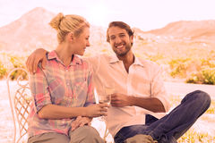 Cute couple sitting in the garden enjoying wine together Royalty Free Stock Photography