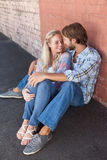 Cute couple sitting on ground Royalty Free Stock Image