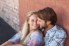 Cute couple sitting on ground Stock Image