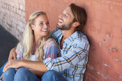 Cute couple sitting on ground Royalty Free Stock Photography