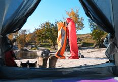 Cute couple in sleeping bags outdoors. View from camping tent stock photo