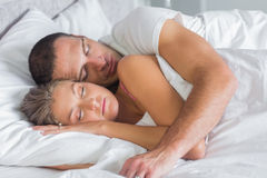 Cute couple sleeping and cuddling in bed. At home in bedroom stock images