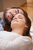 Cute couple sleeping on the floor Royalty Free Stock Images