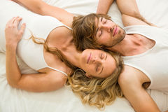 Cute couple sleeping on their bed Royalty Free Stock Photos