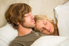 Cute couple sleeping on their bed Royalty Free Stock Photo