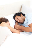 Cute couple sleeping together in their bed Royalty Free Stock Images