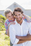Cute couple smiling at camera together in their garden Stock Photos