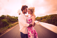 Cute couple standing on the road hugging Royalty Free Stock Photo