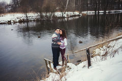 Cute couple standing in a winter park Stock Photo
