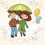 Cute couple strolling through the rain Stock Photo