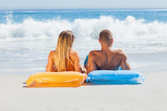 Cute couple in swimsuit sunbathing together. On the beach Royalty Free Stock Images