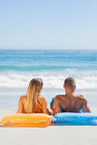 Cute couple in swimsuit taking sun Stock Images