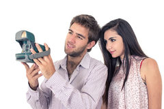 Cute couple taking photos with instant old camera Stock Photography