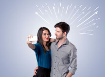 Cute couple taking selfie with arrows Stock Image