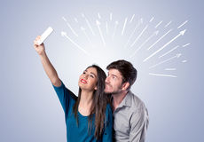 Cute couple taking selfie with arrows Royalty Free Stock Photo